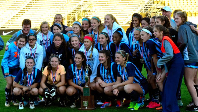 Cincinnati Country Day's girls' soccer team poses with the trophy after falling in the Div. 3 girls' soccer state championship, November 12, 2016.