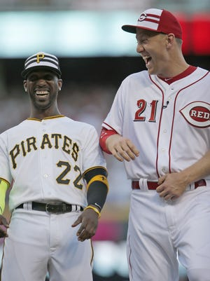 Todd Frazier of the Reds laughs with Pirates outfielder Andrew McCutchen during player introductions ahead of the 2015 MLB All-Star Game.