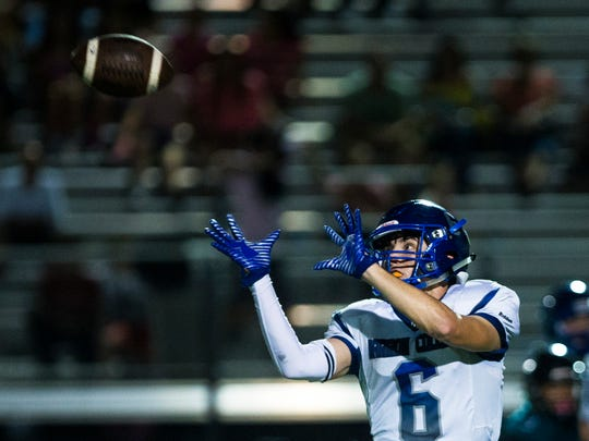 Barron Collier wide receiver Drew Powell, #6, catches a pass during the Catfish Bowl at Gulf Coast High School in North Naples on Friday, Oct. 06, 2017. The Cougars defeated the Sharks 45-12.