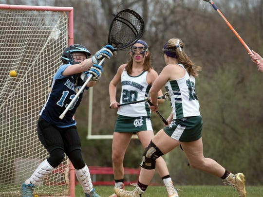 Colts Neck's Ally Largey puts a goal in during first half action. Freehold Township Girls Lacrosse vs Colts Neck in Colts Neck, NJ on April 24, 2018.