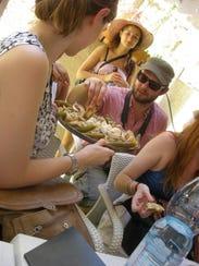 Mark Kurlyandchik samples food during a culinary tour