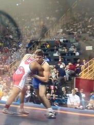 Lexington grad Jacob Kasper wrestles with Zach Merrill