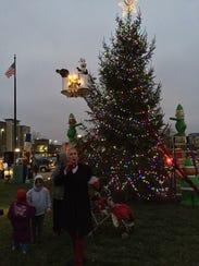 Dale Basham emcees DWNTWN Muncie's annual Light Up