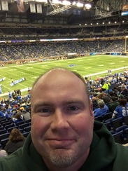 Paul Kollmorgen snaps a selfie near his seats at Ford
