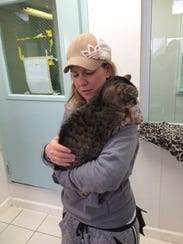 Kristin Barber holding 13-year-old Jeanie, a rescue
