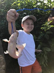 Ethan Pickett, age 7, also caught an albino catfish