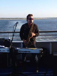 Glass Onion frontman Dale Teat performs aboard the