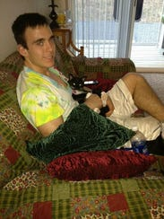 Caleb Byers, 20, with his cat a few weeks after he