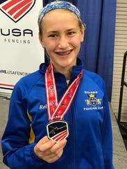 Rebekah Bucur shows off her silver medal earned at