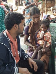 Pastor Sekhar Babu Mandha with a child in India