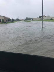 Flood waters have turned streets into rivers Wednesday