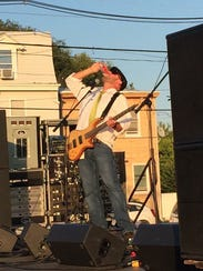 Guitarist Kevin Young takes a drink on stage at last