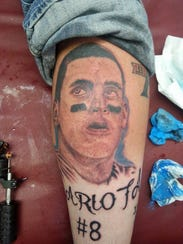 One of Mitcht Firkins 33 Titans-themed tattoos is this