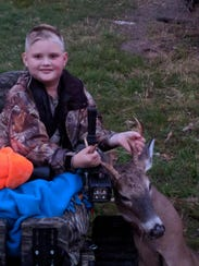 Charlie Denton, 9, shot a deer from his track chair
