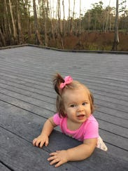 Marie Guidry, 10 months, checks out a large stage used
