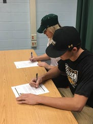 Maggie Cannon and Andrew Smith sign their national letters of intent at Parkside High School.