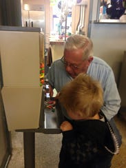 Norm Immel helps a young patron get a special treat