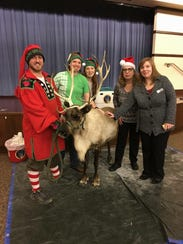 Library staff visited with a live reindeer and elf