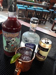 The Desert Berry Mule cocktail made with Chaco Flaco's