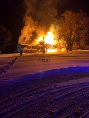 A house on Danby Road in Ithaca was engulfed in flames