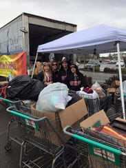 Shelton High School cheerleaders help collect donations