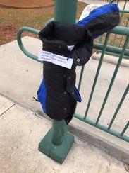 A coat is tied to a pole in downtown Lafayette with