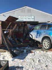 A photo posted to Pucillo's Facebook page shows the wreckage after a car plunged into the restaurant's kitchen in January.