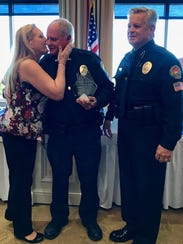 "Marco Island Police Department (MIPD) marine officer Robert Marvin (center) receives a kiss from his wife after being named the 2017 Officer of the Year during the Marco Island Police Foundation's ""Lunch with the Chief"" event on January 16, 2018. Marvin has been with the MIPD since 2012."
