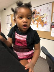 The mother of this 3-year-old girl has been arrested after the child was found wandering an Easley Street alone.