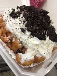 Funnel Cakes are one of the top sellers for Cliff's