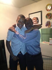 Hallice Cooke, left, with his father Robert.
