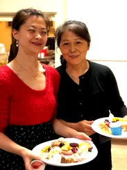 Sherry Dou, left, and her mother, Ping Lu, filled their