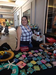 Pinning Memories vendor Andrea Lopez at the Indian