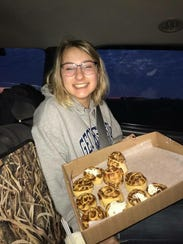 Katrina Pokory gets ready to deliver cinnamon rolls