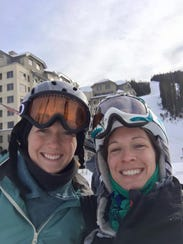 Sioux Falls native Ashley Van Hemert (right) is working toward recovery after being shot multiple times at her Montana home in January. She's pictured here on one of her earlier ski trips.