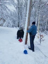 Howell Police Patrolman John Louhier keeps a utility