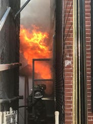 Firefighters battle an early morning blaze at a commercial