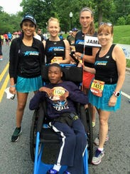 Athletes Serving Athletes, in which runners take wheelchair-dependent