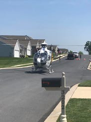 A helicopter arrives to the Fair Wynd neighborhood