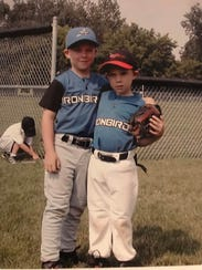 Brenan (right) and Evan Hanifee pose for a picture