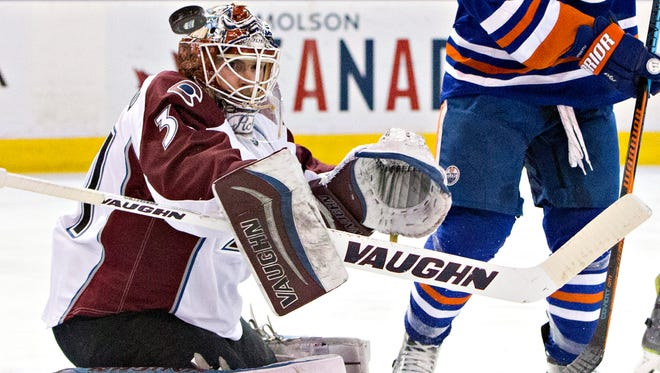 Colorado Avalanche goalie Calvin Pickard (31) makes the save against the Edmonton Oilers during second period NHL action in Edmonton, Alberta, Sunday March 20, 2016.