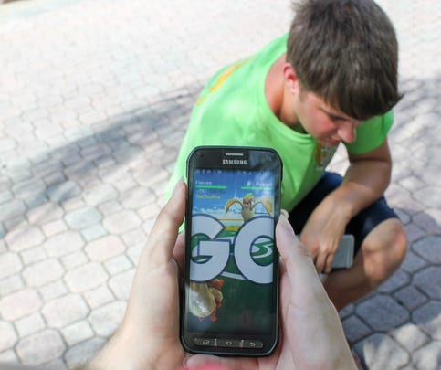 A UCF student deploys his Flareon to take on an opposing Pidgeot at a Pokemon Go gym on campus on July 11.