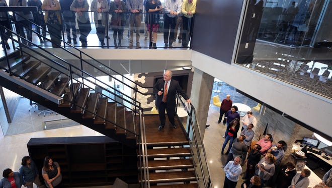 Bob Higgins, CEO and President of Barge Waggoner, welcomes everyone to their new office building in SoBro Monday November 27, 2017.