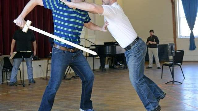 Galen Scott Bower, left, and Geoff Cox rehearse for the Asheville Lyric Opera's 'Don Giovanni' at the YMI Cultural Center. The opera will be on stage April 4 and 6 at Diana Wortham Theatre.