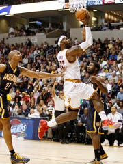 LeBron James (23) drives against Pacers forward David West (21) during the second half at the Cintas Center.