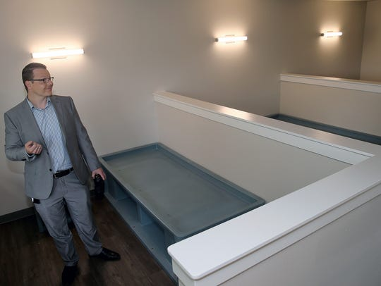 Neil Olson, who will oversee Kitsap Mental Health Services long-awaited crisis triage center in East Bremerton, stands in a clinic bedroom.