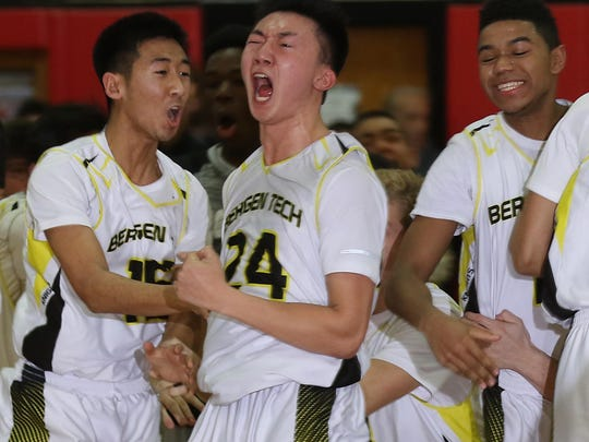 Steve Lai of Bergen Tech reacts after hitting the winning basket with no time left on the clock to give Bergen Tech the win over Saddle River Day.