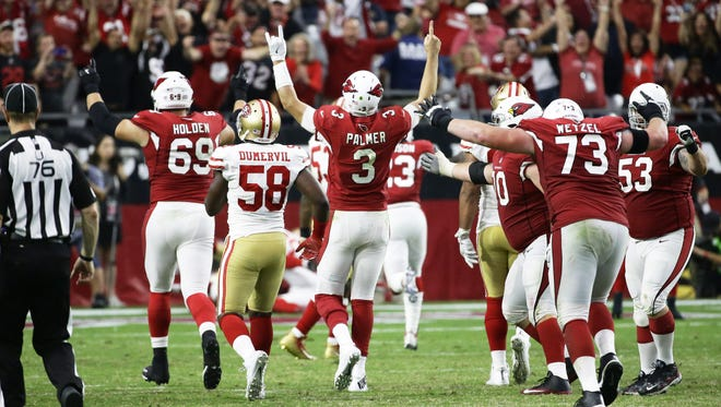 Arizona Cardinals quarterback Carson Palmer reacts after throwing the winning touchdown pass to Larry Fitzgerald to defeat the San Francisco 49ers 18-15in overtime on Oct. 1, 2017 at University of Phoenix Stadium in Glendale, Ariz.