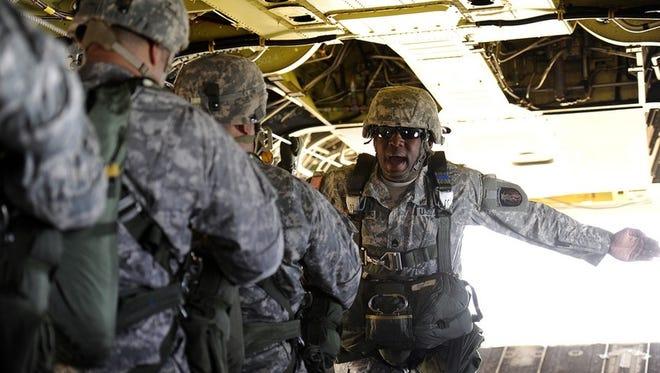 Texas National Guardsmen from C Co, 3-124th CAV go through jump drills.