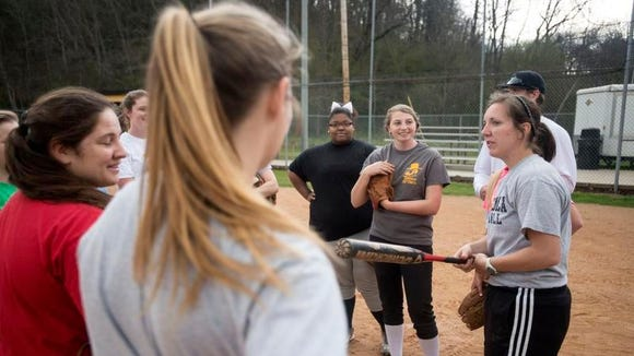 Tuscola softball coach Tara Gibbs talks to her players during Thursday's practice in Waynesville.